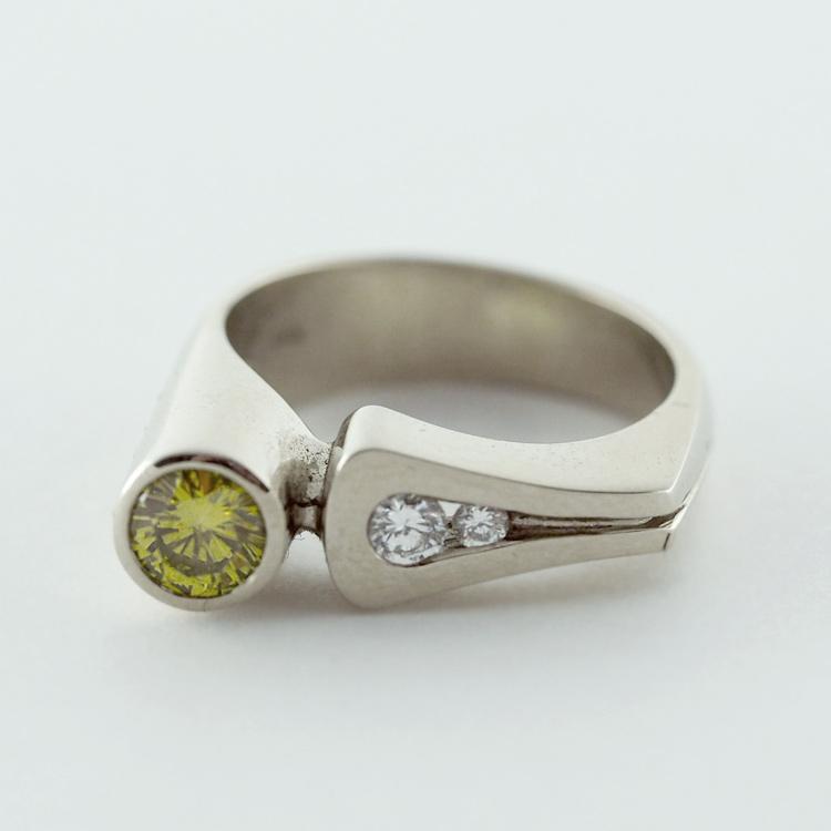 "$4,970<br>19K White Gold, <br>Limited Edition 5/99<br> ""Offset Delight"",<br>Yellow Diamond,<br> 2 Brilliant Cut <br>Diamonds"