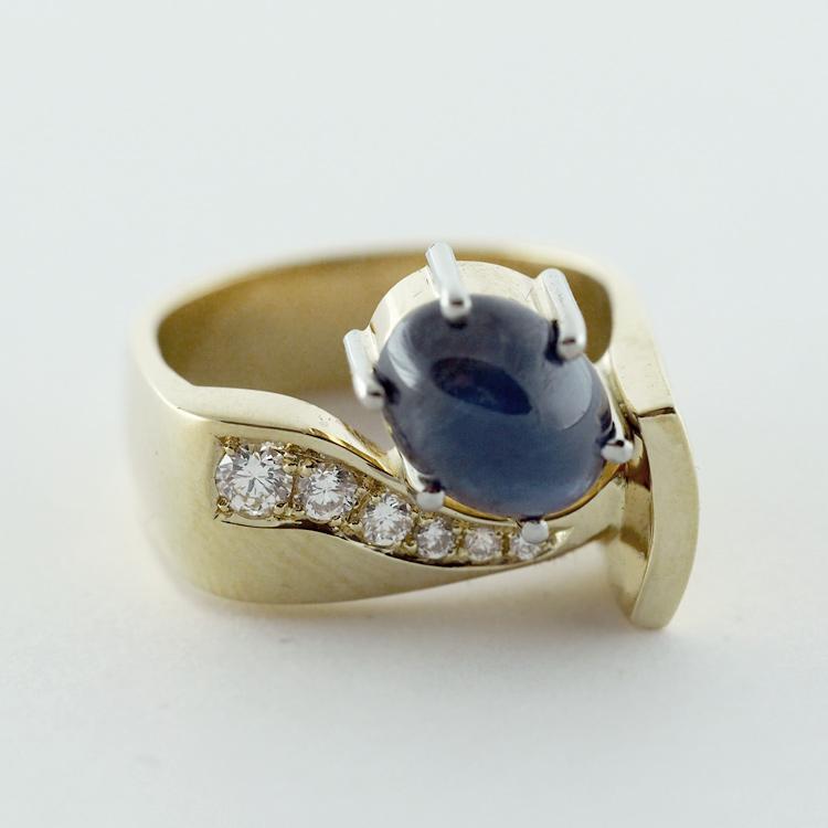 $5,281<br>18K Yellow Gold,<Br> Blue Star Sapphire,<Br> 6 Brilliant Cut <br>Diamonds