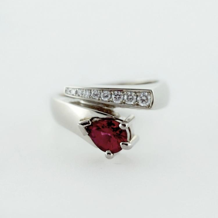 $4,677<br>19K White Gold, <br>Pear Shaped Ruby 0.85 ct,<br> 9 Brilliant Cut<Br> Diamonds