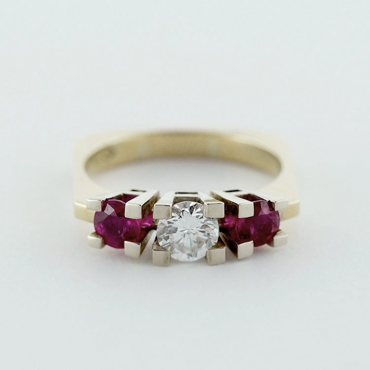 reg.RT: $6,848/Special $5,825<Br>14K Yellow Gold & 19K White Gold,<br> Centre Stone 1 Diamond of<br>0.52 ct, brilliant cut, G-vvs <br> 2 Rubies TW 0.70 ct