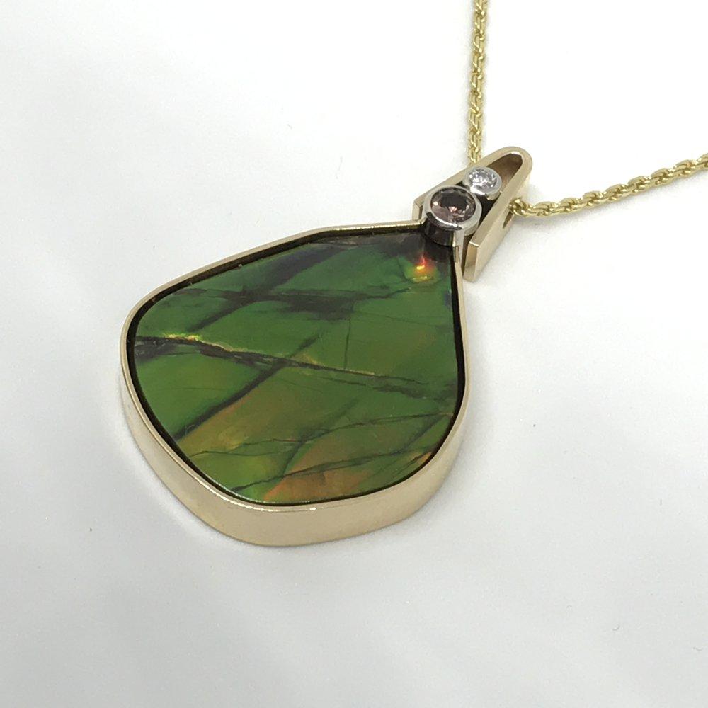 NEW ITEM <br><b>Ammolite Pendant</b><br>$3,367<br>14K Yellow Gold<br>Ammolite 41 ct<br>Pink Sapphire 0.27ct<br>Brilliant Cut Diamond 0.08ct