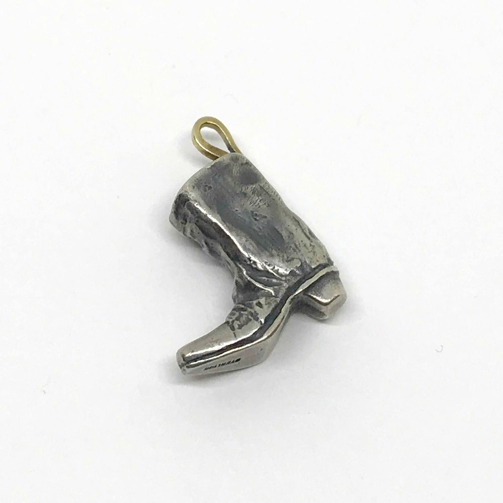 <b>Sterling Silver Boot</b><br>$313<br>18K Yellow Gold Bale