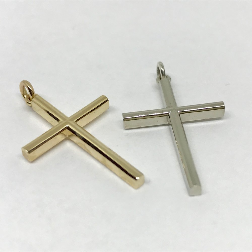 <b>Solid Gold Crosses</b><br>reg.RT: $583ea./Promotion:$466<br>14K Yellow or White Gold<br>Designer Series
