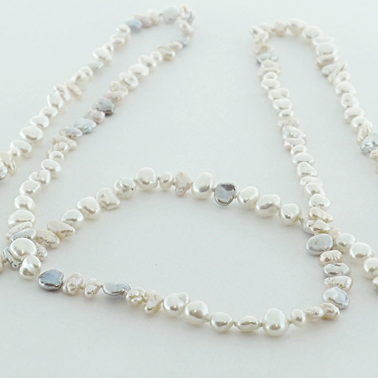 <b>Luxury Wrap</b><Br>$2,772<br>Genuine Biwa <Br>Natural Coloured <br>Fresh Water Pearls