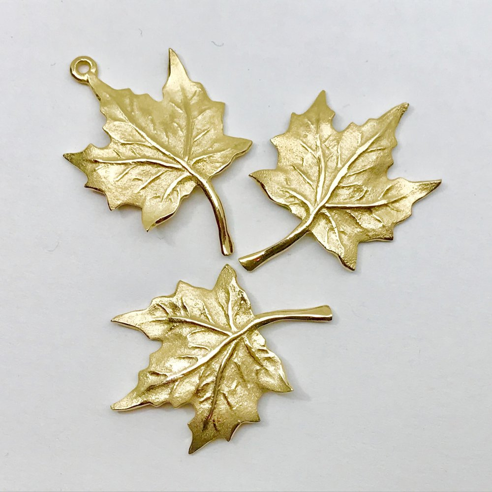 NEW IN STOCK <br><b>Maple Leaf Pendant</b><br>$ 570<br>14K Yellow Gold<br>Designer Series
