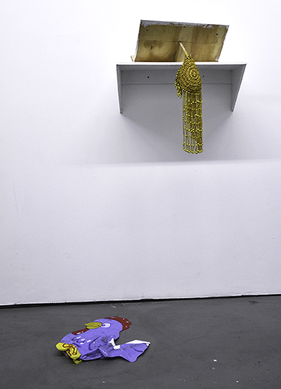 GEO WYETH: artifacts from performance (Gold headpiece, golden knife and plastic chicken), 2014.