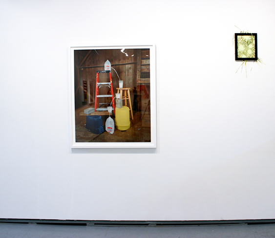 ADAM EKBERG: Transferring a gallon of milk from one container to another, 2014, signed and numbered, verso, archival pigment print (edition of 3), 40 x 30 inches; and DENISE TREIZMAN, Hip Hop Hooray (gold), 2015, metallic paper, frame and spray paint, 19 x 13""