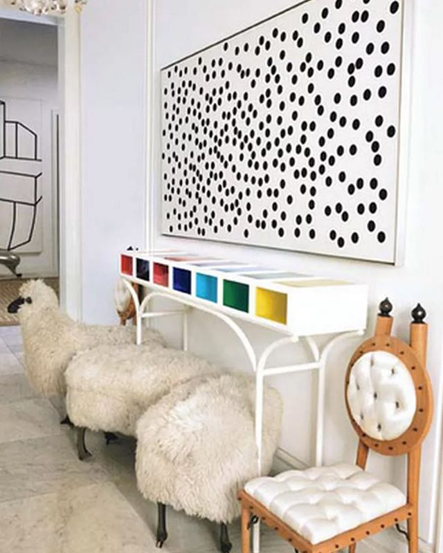A flock of Lalanne sheep meet an Elizabeth Garouste x Mattia Bonetti console while a Liberman dot painting oversees the gathering by @delphinereedkrakoff. #inspiration #genius #nyc #interior #onourbookshelves photo by @ivanterestchenko in Houses That We Dreamt Of: The Interiors of Delphine and Reed Krakoff