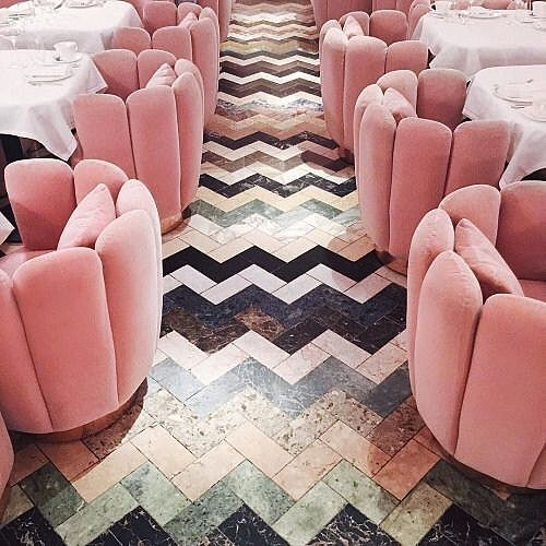 I love using seating that makes a statement and that you can't resist sinking into. The army of custom bubblegum pink velvet chairs at The Gallery Restaurant in @sketchlondon designed by @indiamahdavi are irresistible on contrasting chevron. #sitstaylove #JMHinteriors #decorlovers #interiordesign