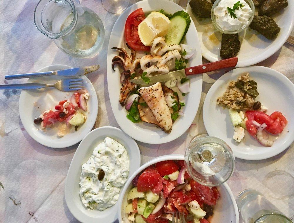 Fried Calamari and Greek Salad paired with Cretan white wine.