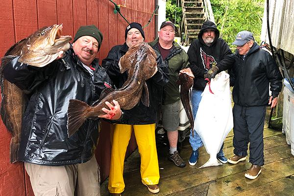 charter-anglers-with-huge-lingcod-se-alaska.jpg