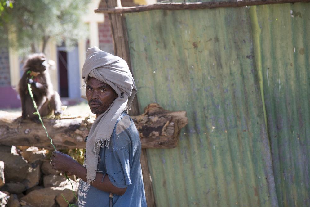 Farmer with his monkey outside Gondar, Ethiopia