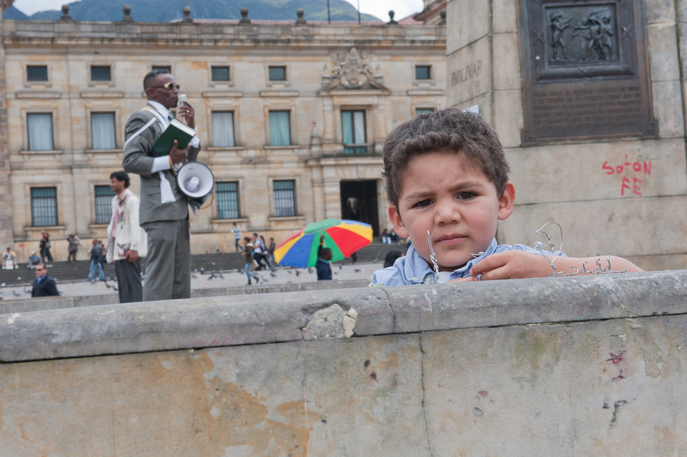 Young boy at a rally in Bogota, Colombia