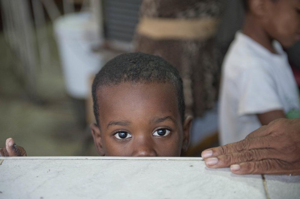 Child at bodega in Havana, Cuba