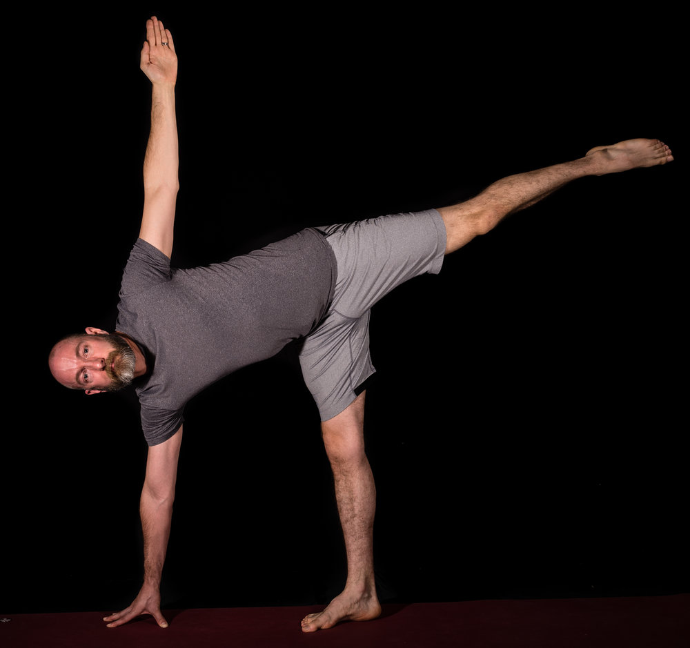 "David practising Balance in the ""Ardha Candrasana"" or Half Moon Pose"