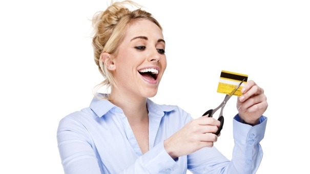 Nothing makes you smile quite like cutting up a credit card in a stock photo