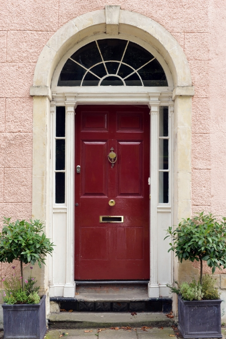 stock-photo-front-door-of-an-old-english-town-house-477116908.jpg
