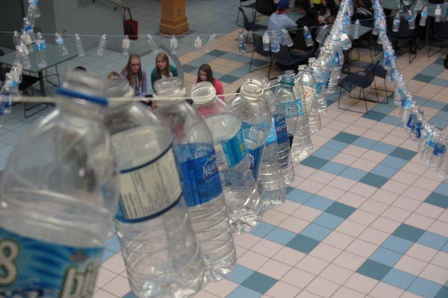 Plastic water bottles strung across cafeteria at Horton High School