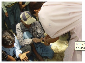 Checking people for symptoms of arsenic poisoning during an awareness workshop;   http://www.filtersforfamilies.org/