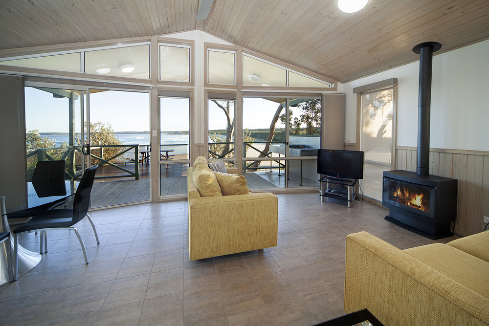 Oceanfront Deluxe, Chalet 17 living area 1 with fire.jpg
