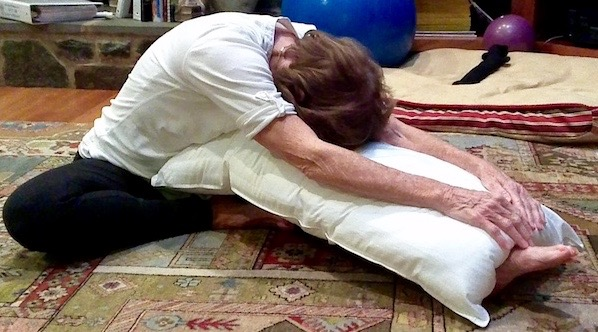 Half Butterfly Pose (Janu Sirsasana) with head supported