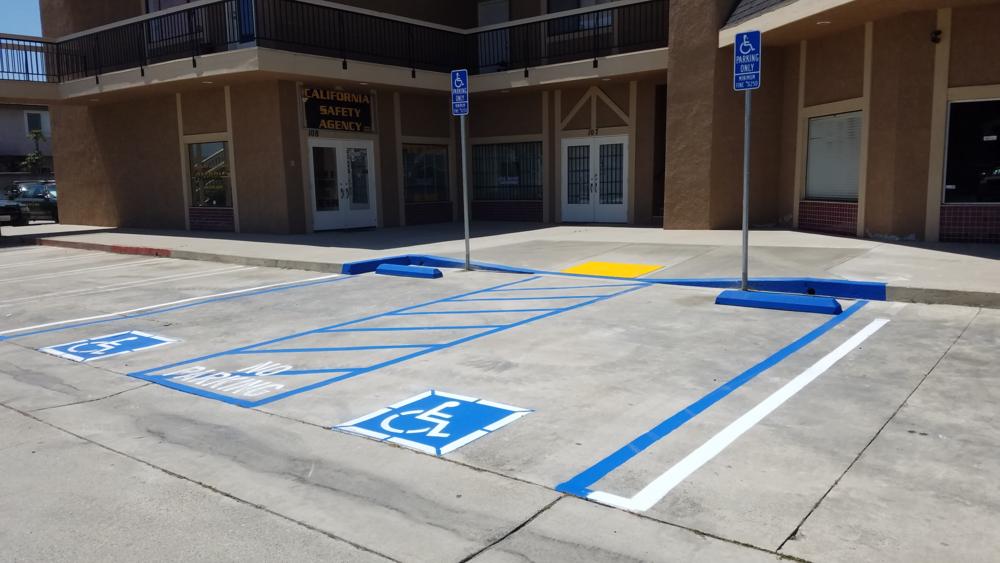 Concrete ADA Compliance. Handicap signs with Truncated Dome