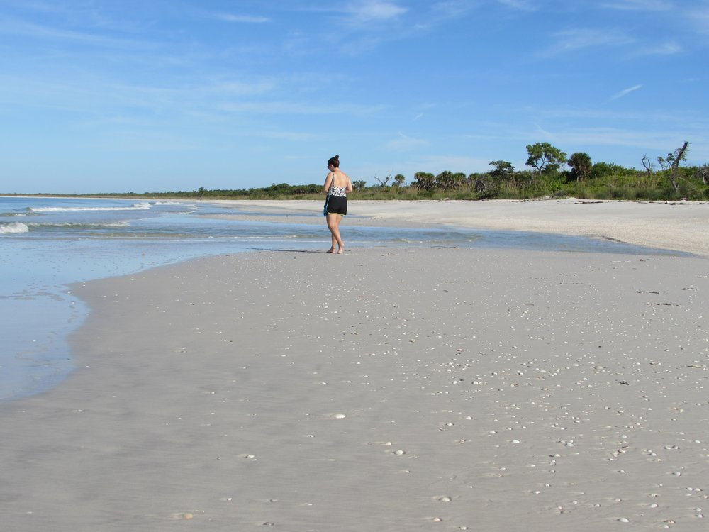 Emmett took this picture -me walking the beach at low tide in Cayo Costa State Park.