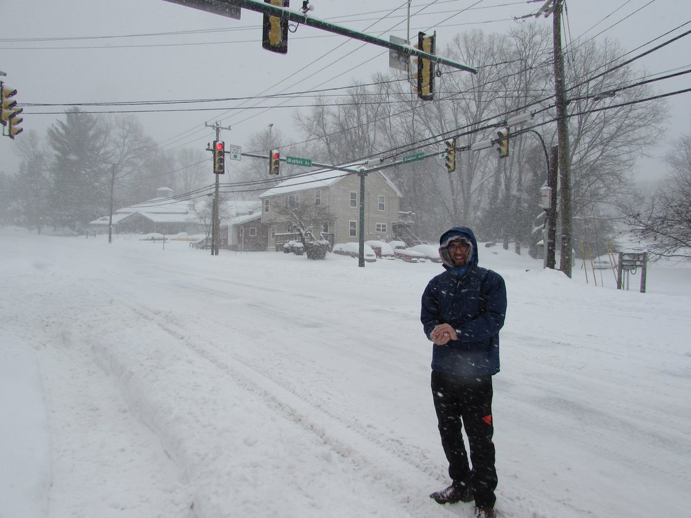 Emmett making a snowball in the middle of Preston Avenue during 2016's big snow.