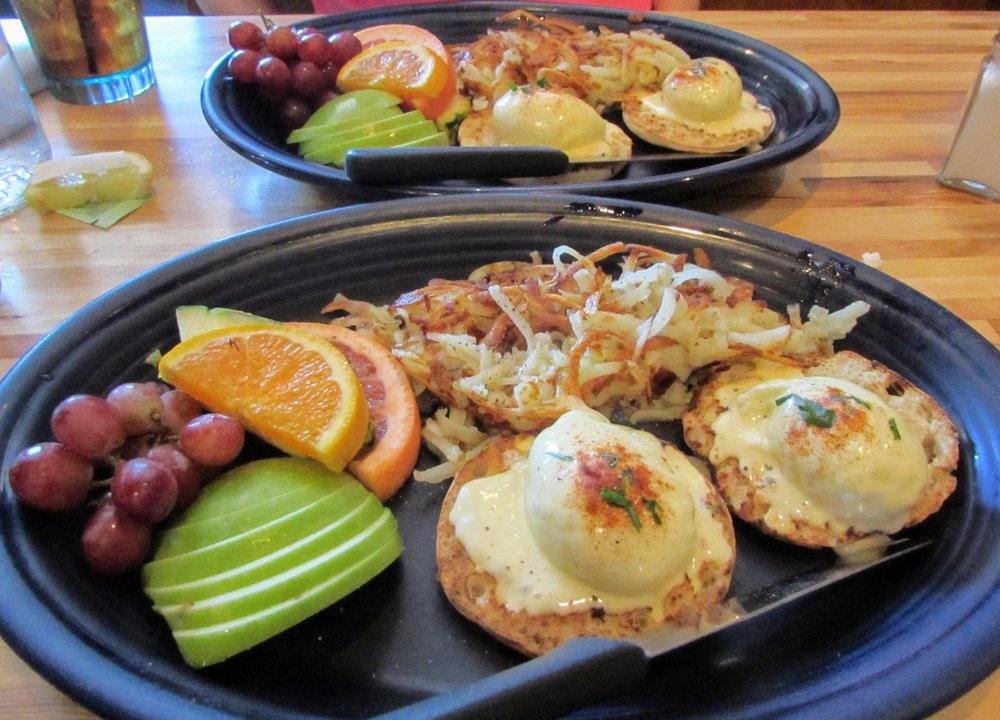 Eggs Benedict, hashbrowns, and fresh fruit: a tasty brunch from Hot Suppa.
