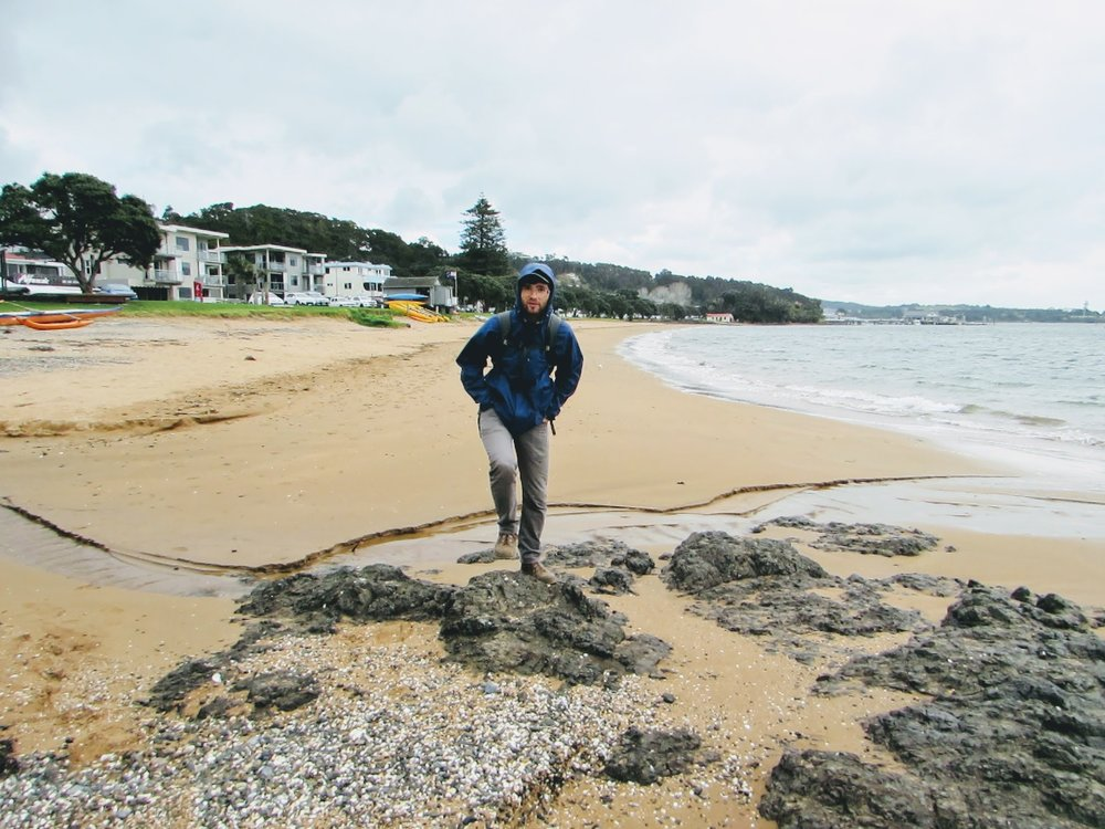 Emmett on a typical New Zealand rainy day on Paihia's beach.