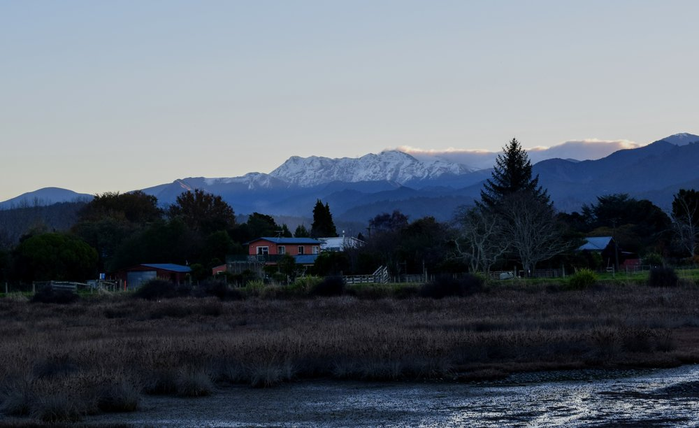 Kahurangi National Park's snow-capped Mount Arthur, as seen from the Motueka Inlet Walk.