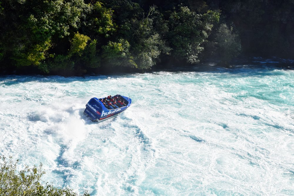 A jetboat in the churning waters below Huka Falls.