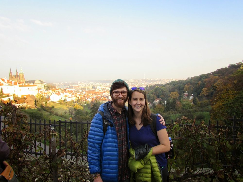 One of the last pictures before our new camera's battery gave out on us prematurely. Us with Prague behind, taken by our tour guide.