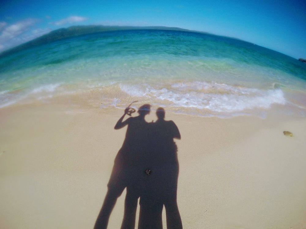 Our shadowy snorkeling selves on beautiful Pele Island in Vanuatu.