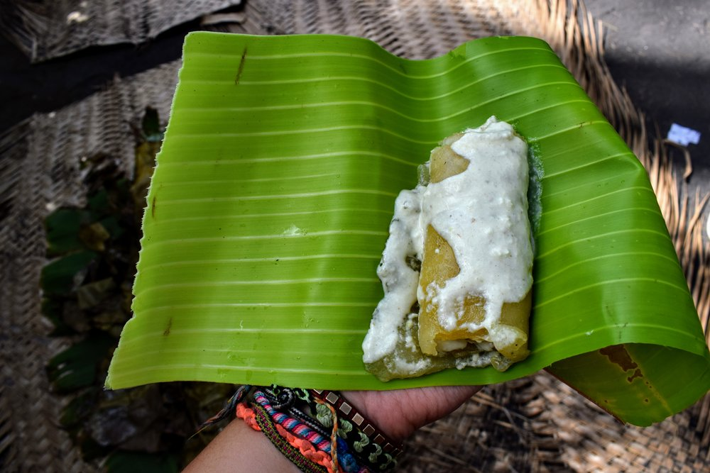 The finished product: rolled laplap on a banana leaf plate.