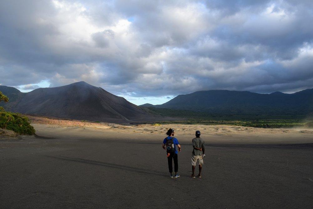 Emmett and Malakai on the ash plain.