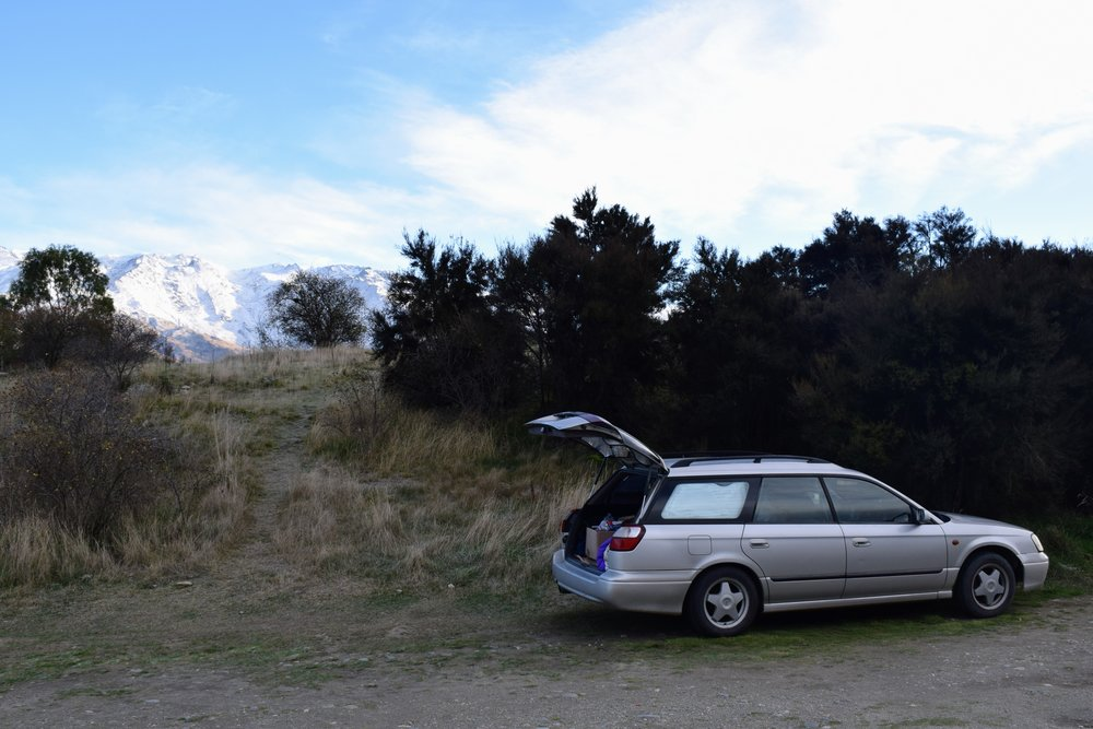 It was hella cold and windy at our free camp site outside of Cromwell, NZ. Note those snowy peaks in the background.