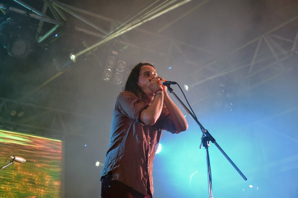 Lead singer of The Murlocs Ambrose Kenny-Smith during a harmonica solo.