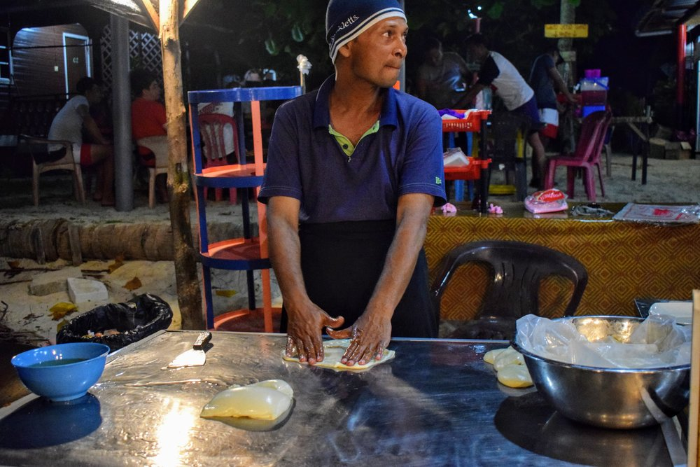 "The ""number one roti"" creator of Fatima Chalet on Perhentian Kecil, Malaysia! Indeed, I think his were the best we had on-island."