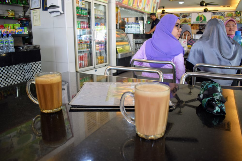 Left is Kopi Tarik (Malaysian-style coffee) and Right is Teh Tarik (Malaysian-style tea).