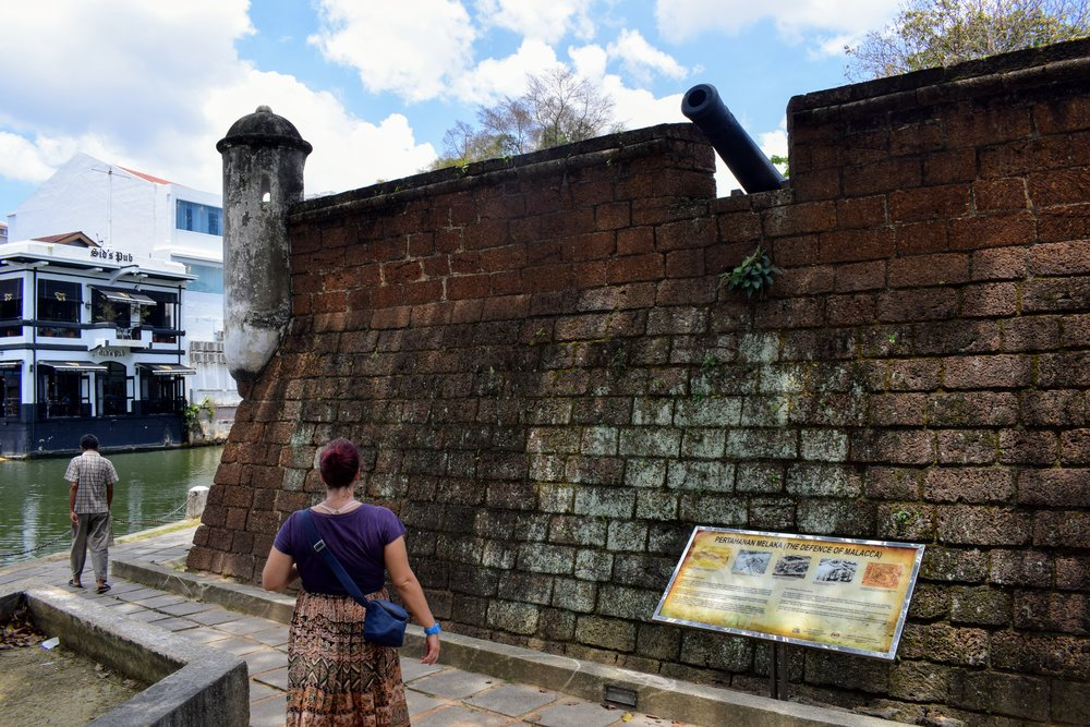 Walking along the old Dutch fort along the Melaka river.