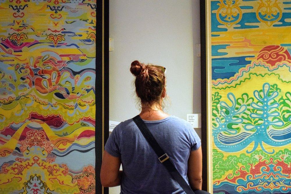 Checking out some very cool batik paintings at Batik Painting Museum Penang.