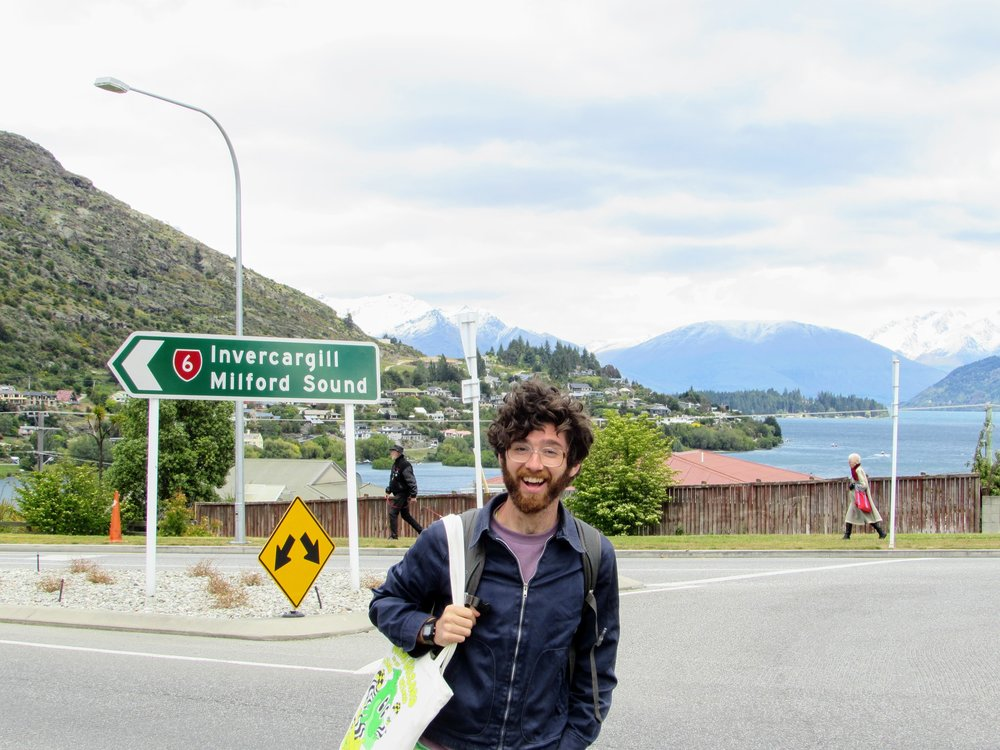 Emmett waiting for a ride from Queenstown to Invercargill, NZ.