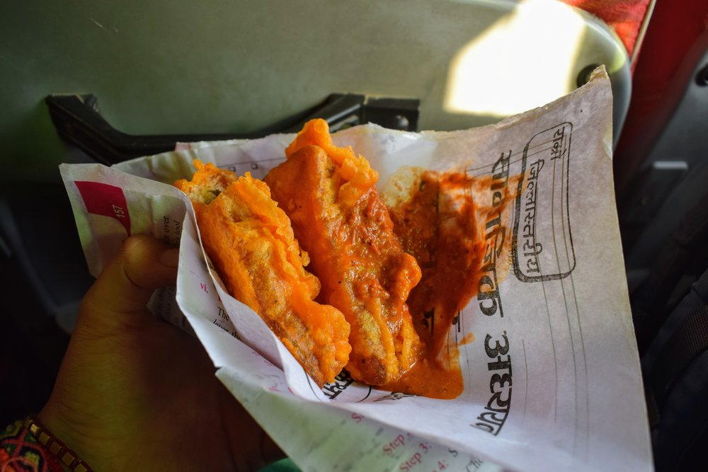 Pakora that Emmett bought from a street vendor outside our window at a bus station.