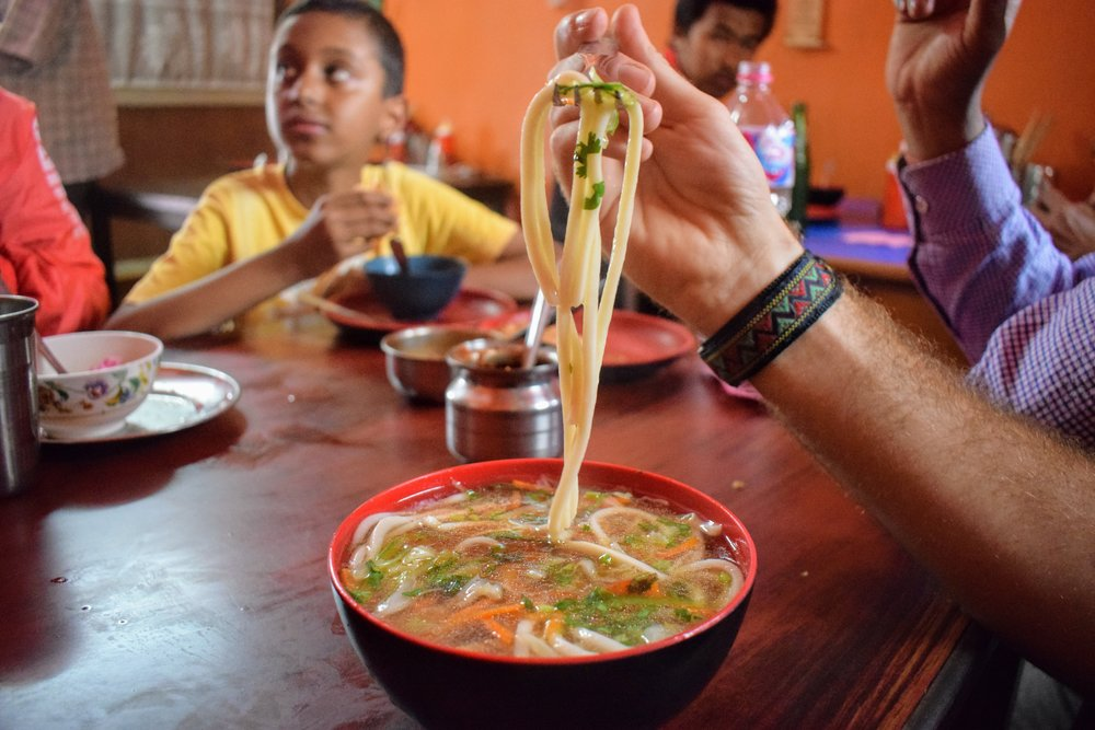 A piping hot bowl of thukpa at a hole-in-the-wall in central Pokhara.