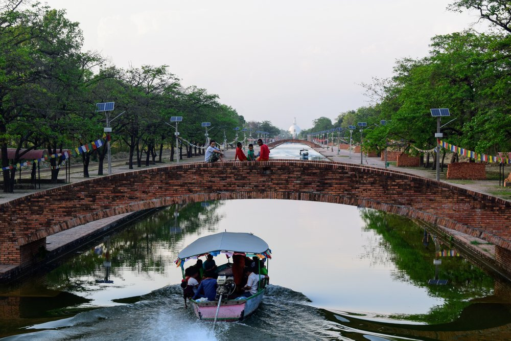 A motorboat takes tourists down the Central Canal towards the World Peace Pagoda.