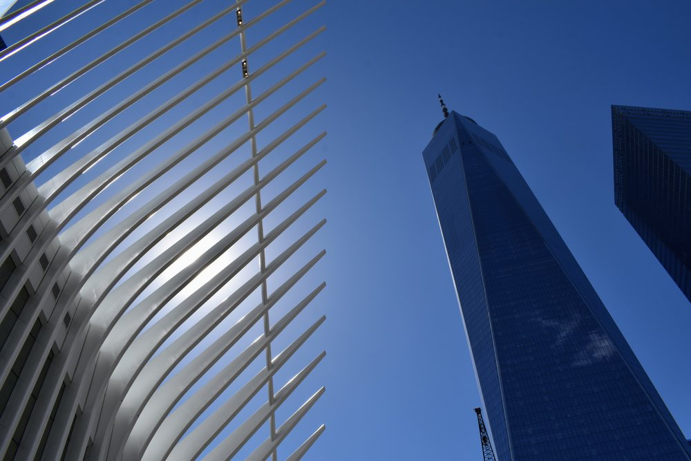 One World Tower rises high above the September 11th Memorial.