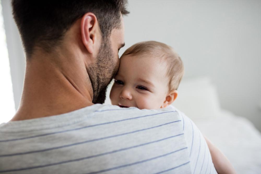 Dad with newborn over shoulder.jpeg