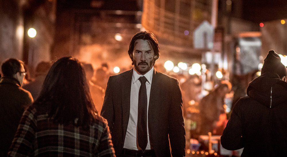 """John Wick: Chapter Two"" (2017)  - Directed by: Chad Stahleski Written by: Derek KolstadStarring:Keanu Reeves - John Wick Laurence Fishburne - Bowery King Common - Cassian Ian Shane - Winston Riccardo Scamarcio - Santino D'Antonio Claudia Gerini - Gianna D'Antonio Ruby Rose - Ares Lance Reddick - Charon Country: U.S.A"
