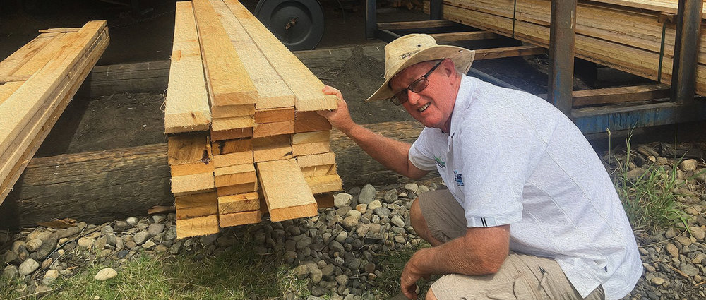 Robert Young, manager of our Boat Building committee, inspecting the first trial cuts of our selected, Yellow Stringy Bark Planks at the MecTec Timber Mill, near Orbost Victoria.